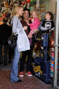 Paul Stanley lays a kiss on his little cutie